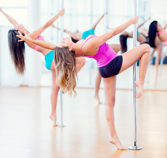 Women doing pole workouts in a fitness class
