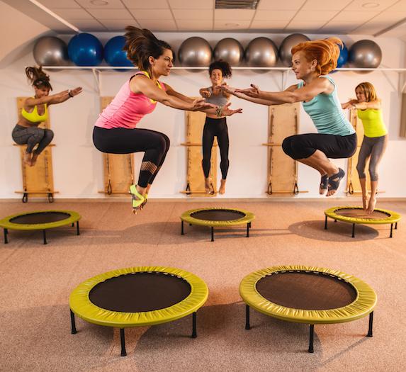 Women jumping on trampolines