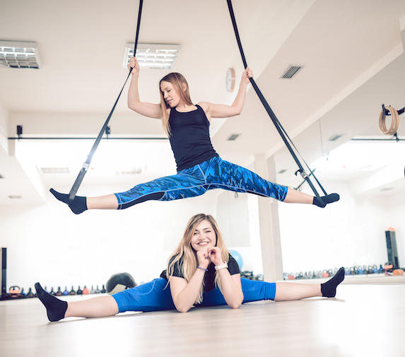 Stretching and aerial aerobics in a small gym setting