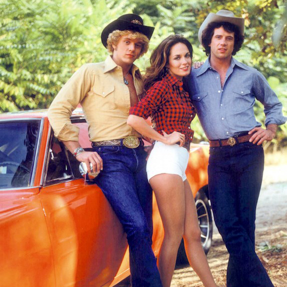 Catherine Bach poses with her Dukes of Hazzard co-stars in a promotional photo from the set of their 1980 television show