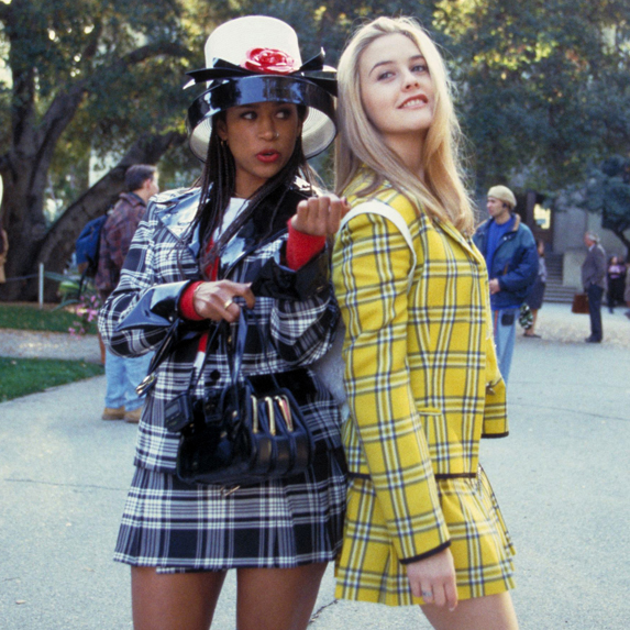 Alicia Silverstone and Stacey Dash pose in character for a photo on the set of their 1990's film