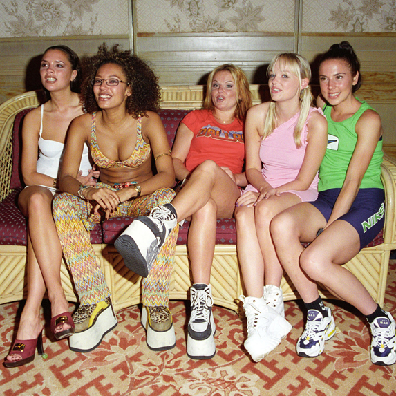 The Spice Girls pose in platform shoes