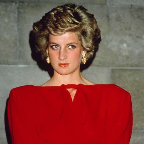 Princess Diana in the 1980's, photographed wearing a red dress with shoulder pads