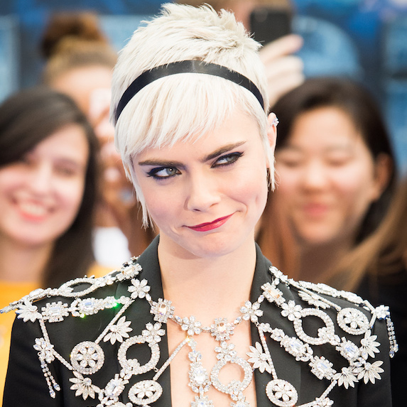 Cara Delevingne wears a statement necklace on the red carpet