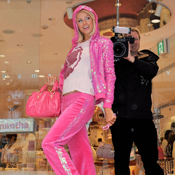 Paris Hilton wears a pink velour tracksuit to a store opening in 2008