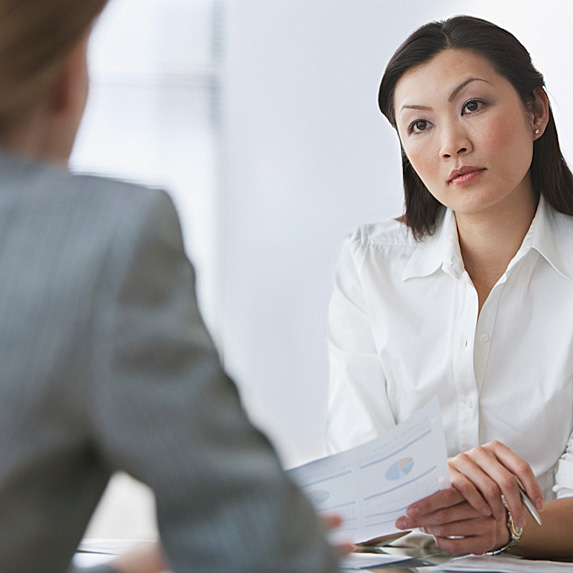 Interviewer looking doubtfully at applicant