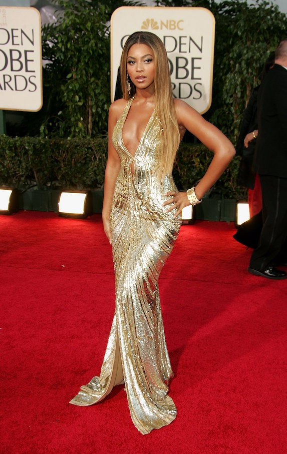 Beyonce wears a metallic gold gown with low-cut neckline to the Golden Globe Awards in 2007