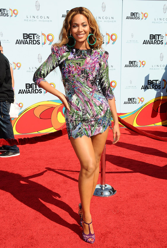 Beyonce wears a sparkly mini dress with oversized hoop earrings to the 2009 BET Awards