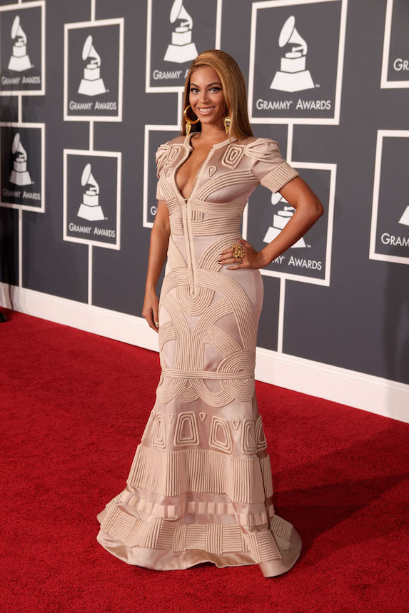 Beyonce wears a fitted, pale pink gown to the 2010 Grammy Awards