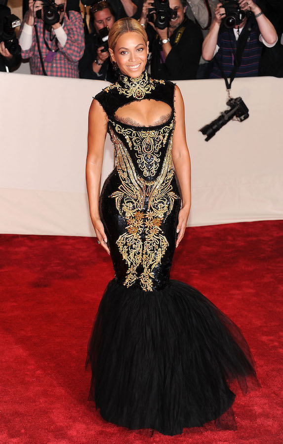 Beyonce wears a black-and-gold gown to the 2011 MET Gala