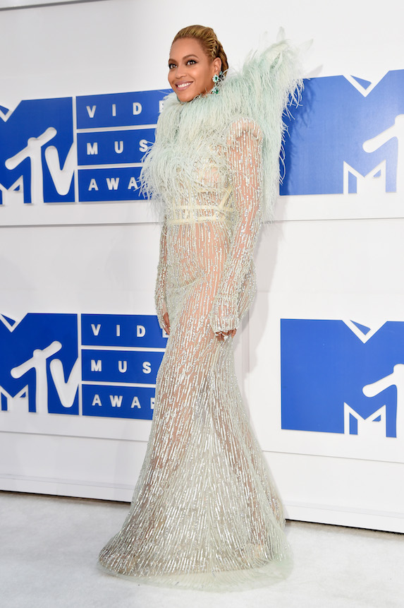 Beyonce wears a pale green-feathered gown to the 2016 MTV Video Music Awards