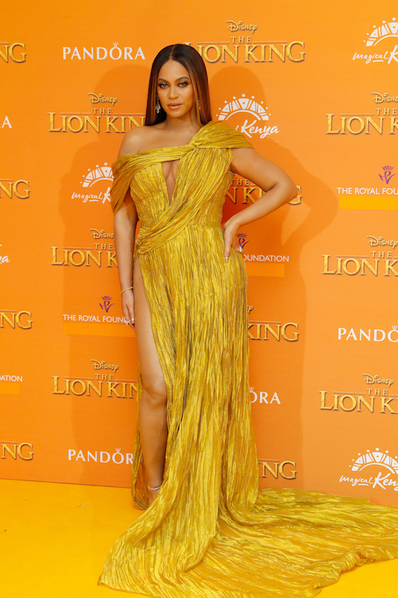 Beyonce wears a gold gown at the European premiere of The Lion King