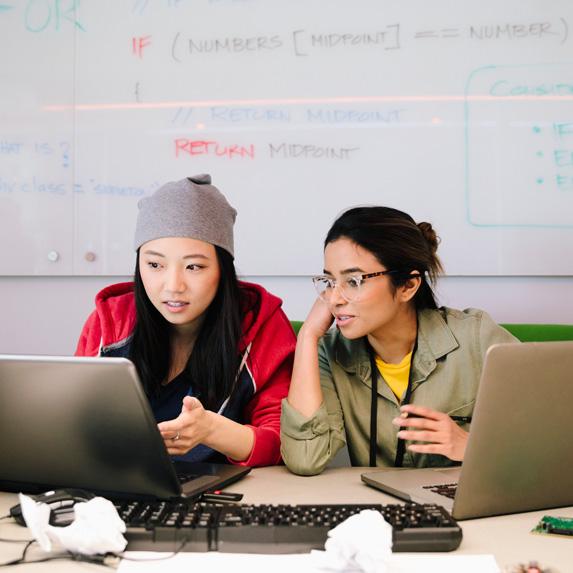 Two women coding