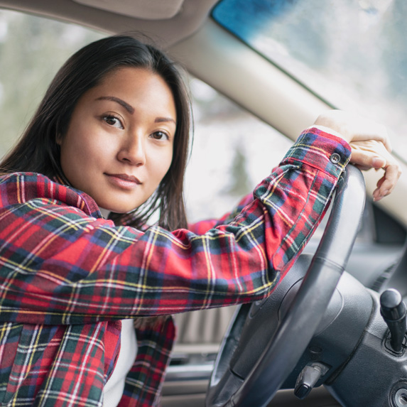 Woman behind the wheel of a car