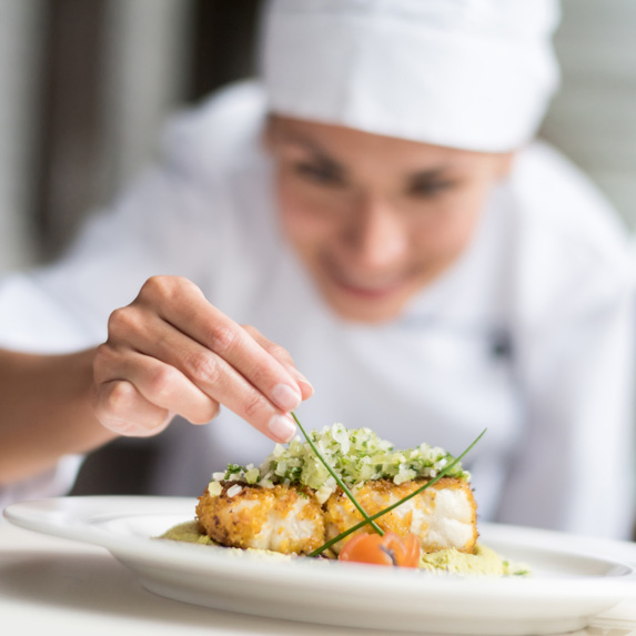 Executive chef working on a plate