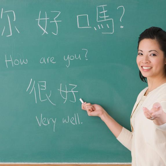 Language teacher in front of blackboard