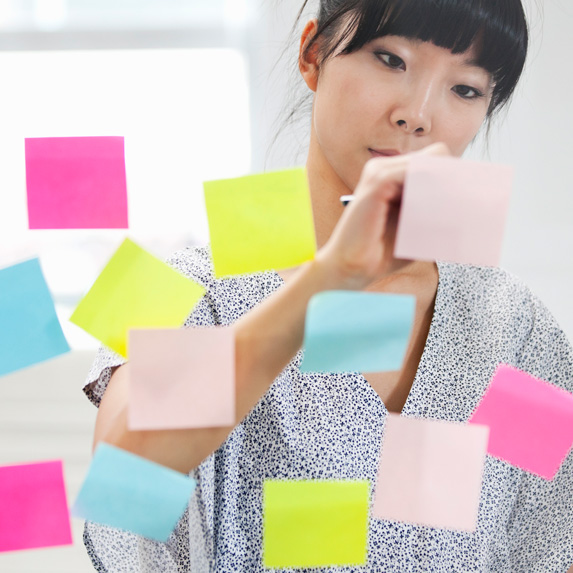 Woman using post-it notes