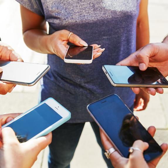Group of people using smartphones