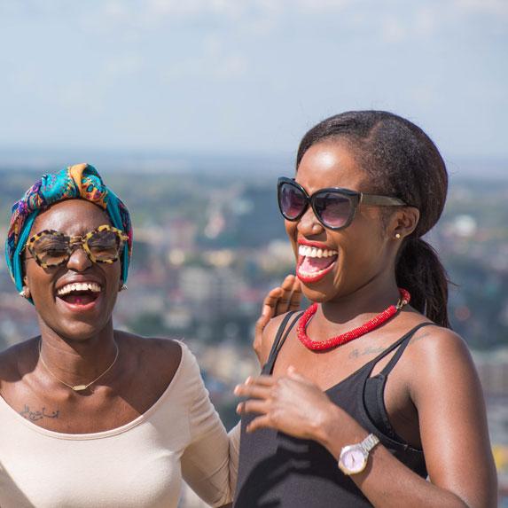 Two black women laughing