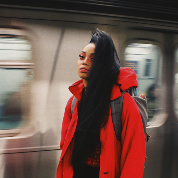 Black woman in subway station