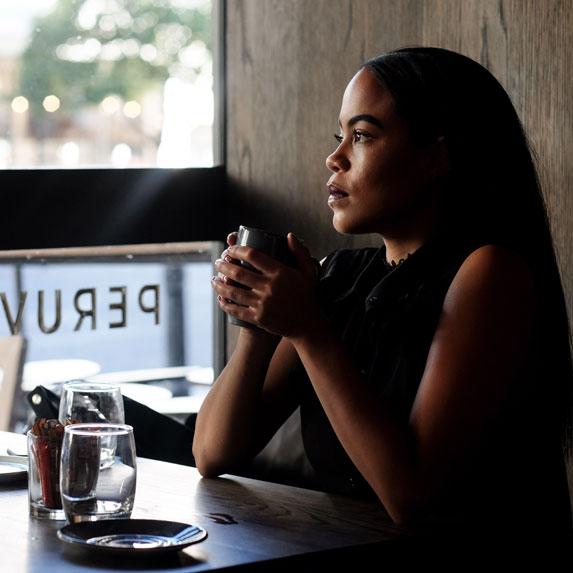 Black woman in coffee shop