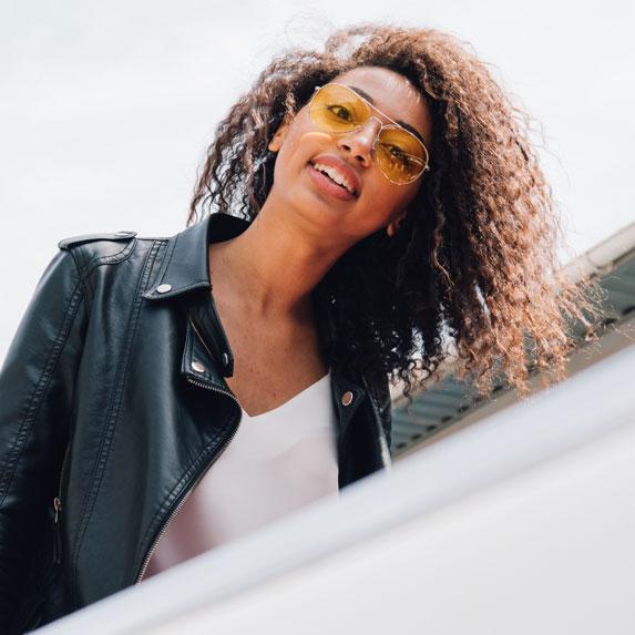 Black woman boarding a plane