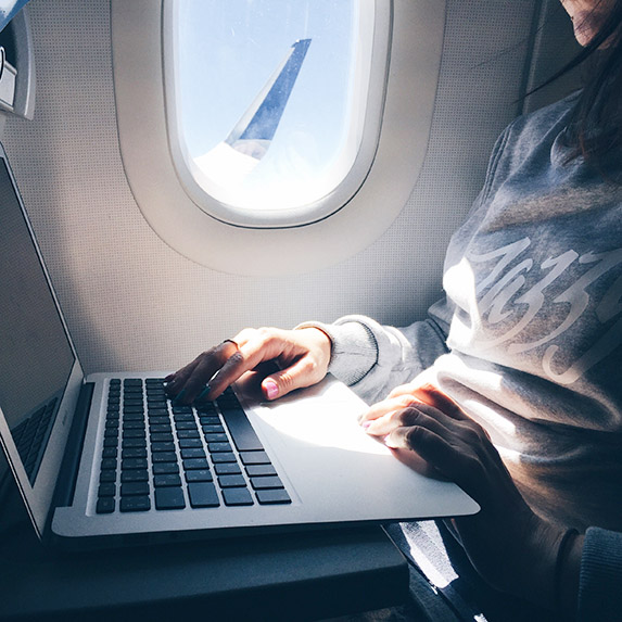 woman with laptop on tray table