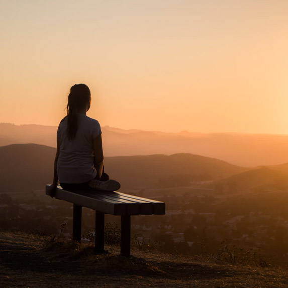 Woman enjoying a sunrise