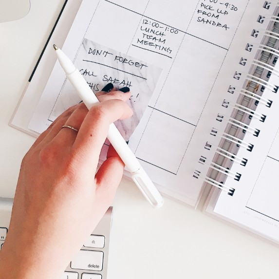 View of a planner and hand.