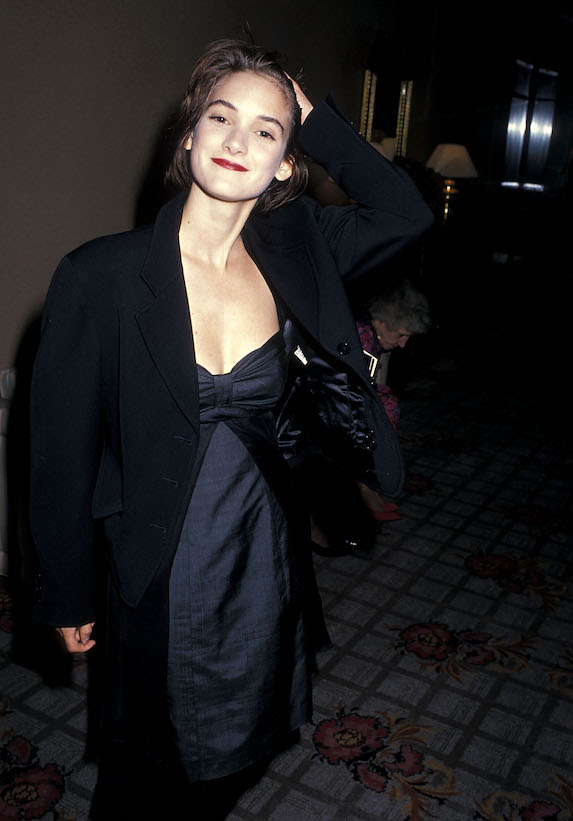 Winona Ryder wears a satin dress and black blazer