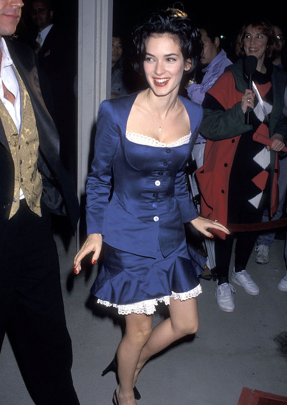 Winona Ryder wears a blue dress to a film premiere in 1992