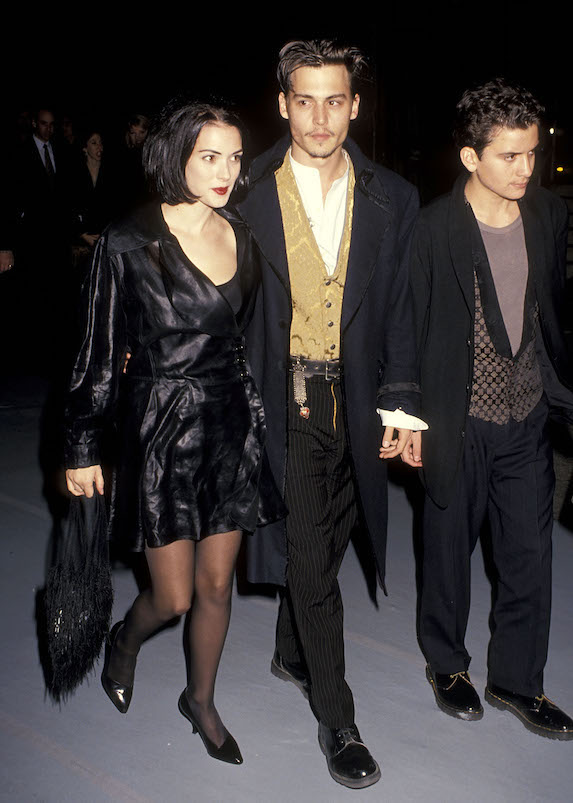 Winona Ryder wears all black to a 1990 film premiere with co-star and then-boyfriend Johnny Depp
