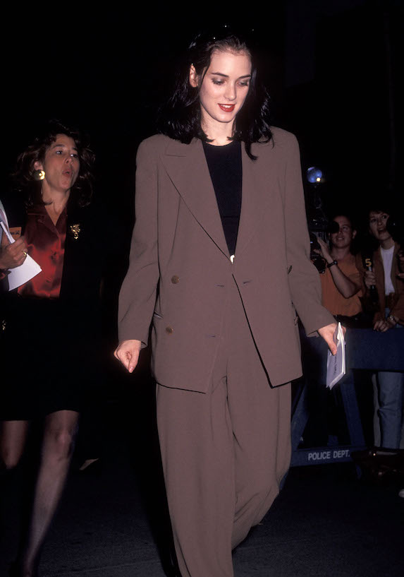 Winona Ryder wears an oversized suit and wingtip shoes to a 1991 film premiere