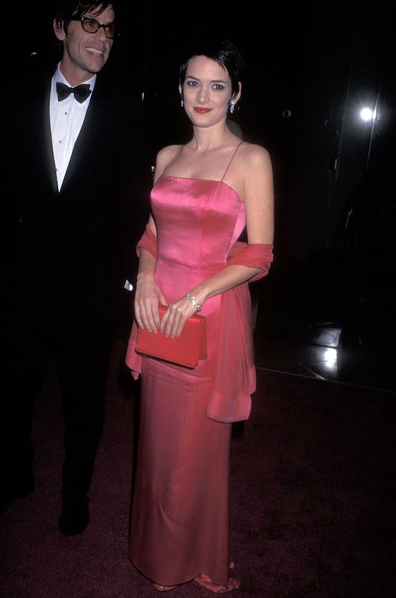Winona Ryder wears a pink satin gown on the red carpet in 1997