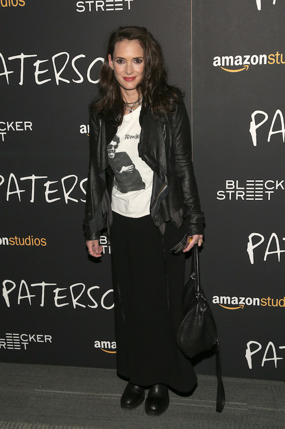 Winona Ryder wears a leather jacket, t-shirt, long skirt and chunky black boots to a film screening in New York in 2016