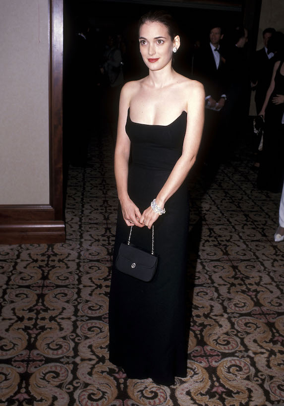 Winona Ryder wears a strapless black gown to an event in 1996