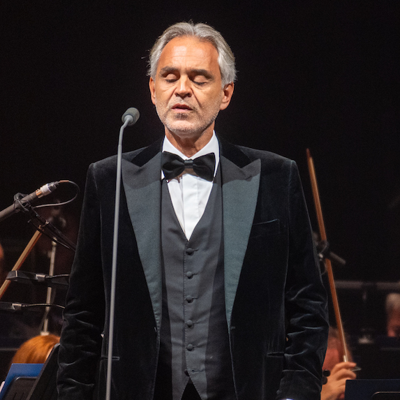 Andrea Bocelli at a concert, singing