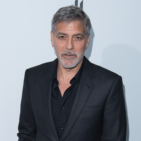 George Clooney in a suit at an event