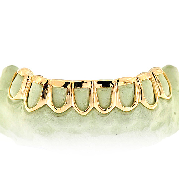 Gold eight-tooth grill