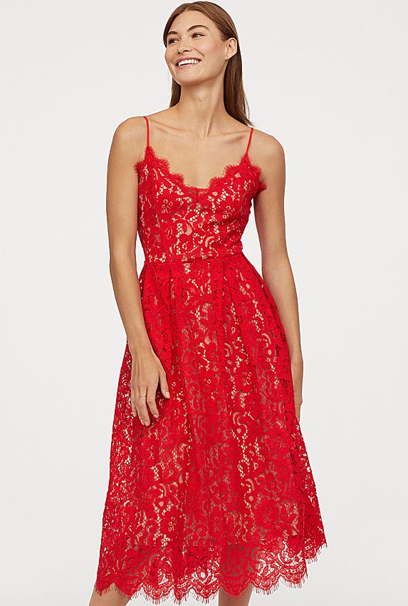Model wearing red lace dress