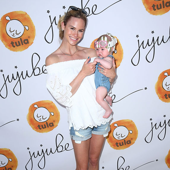 Meghan King Edmonds and child attend Ju-Ju-Be's 2nd Annual Ju-Ju-Beach Event celebrating lthe launch of Baby Tula Collaboration on April 22, 2017 in Laguna Beach, California.