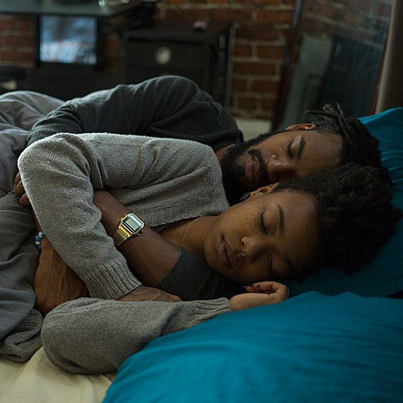 Man and woman sleeping in bed, spooning