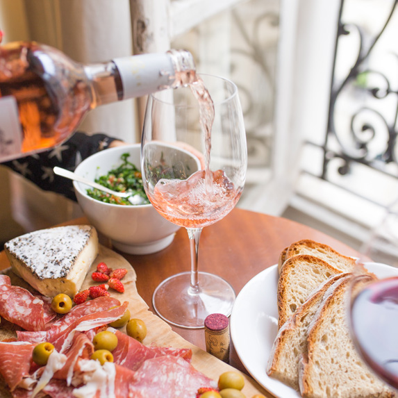 A delicious spread with wine being poured