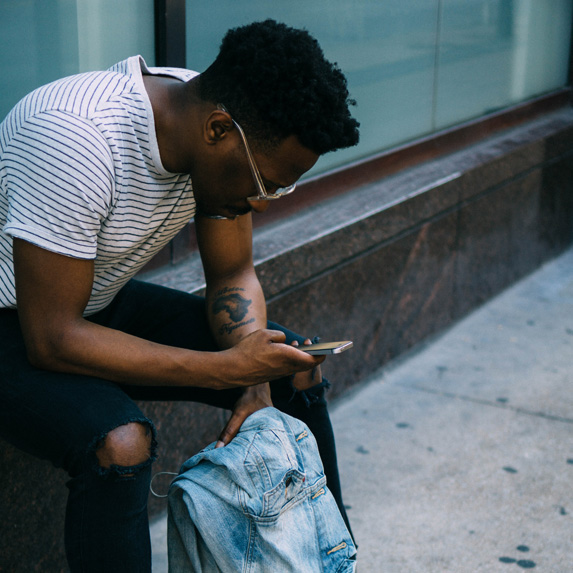 Someone checking their phone outside of a building