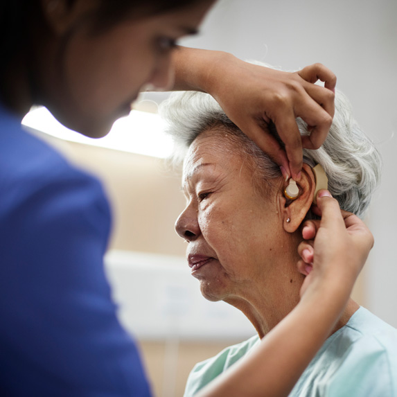 Audiologist and elderly patient
