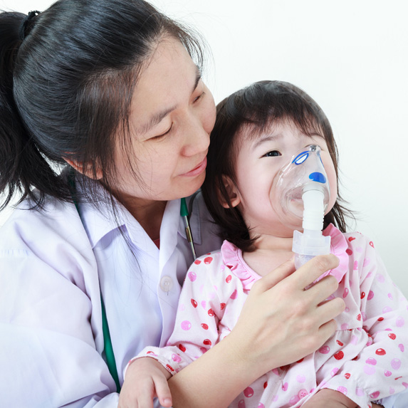 Respiratory therapist and young patient