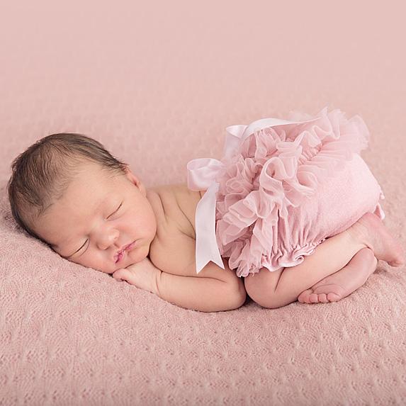 Baby girl posed and sleeping