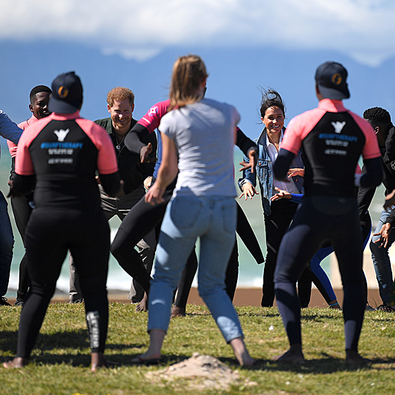 Prince Harry and Duchess Meghan taking part in exercise