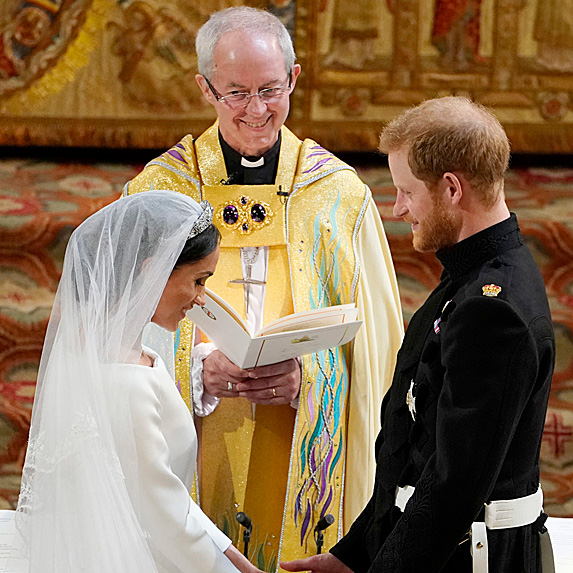 Duchess Meghan and Prince Harry exchanging vows on their wedding day