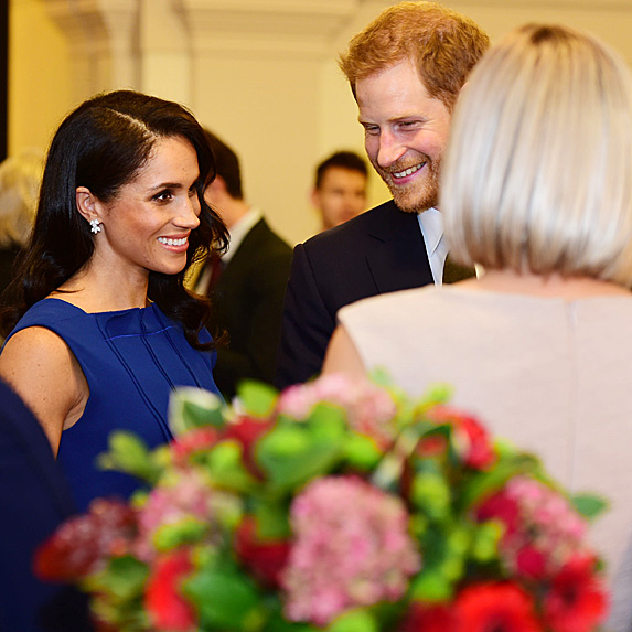 Duchess Meghan and Prince Harry at gala with other guests